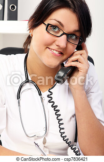 Young woman doctor talking by phone - csp7836421