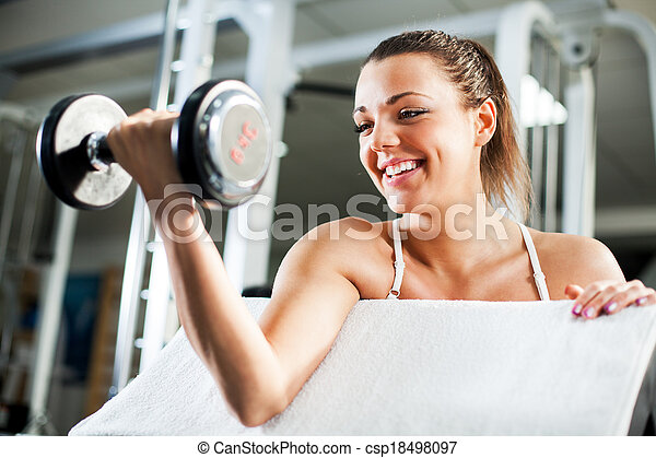 Young woman doing Biceps exercise - csp18498097