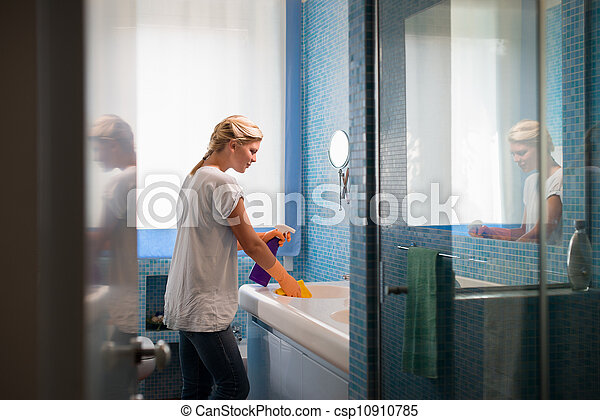 Young woman doing chores and cleaning bathroom at home - csp10910785