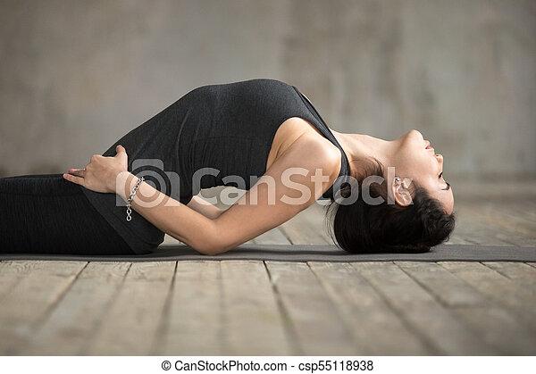 young woman doing matsyasana exercise close up young