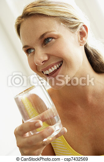 Young Woman Drinking A Glass Of Water - csp7432569