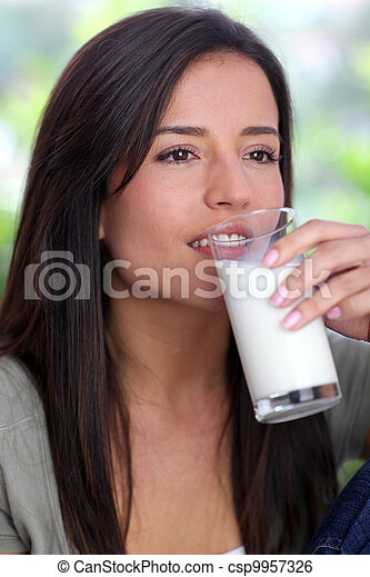 Young woman drinking glass of milk - csp9957326
