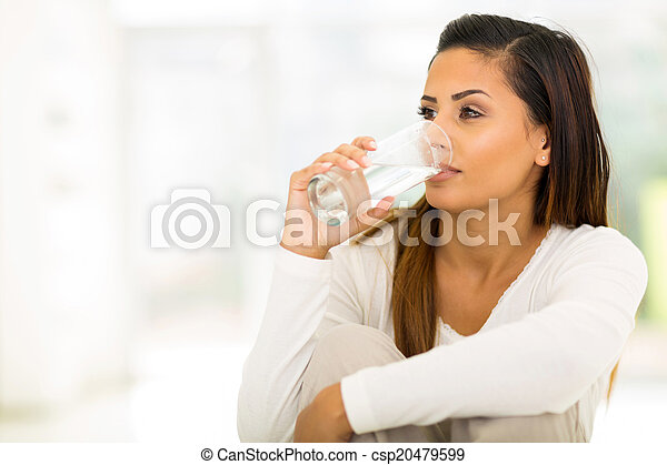 young woman drinking water - csp20479599