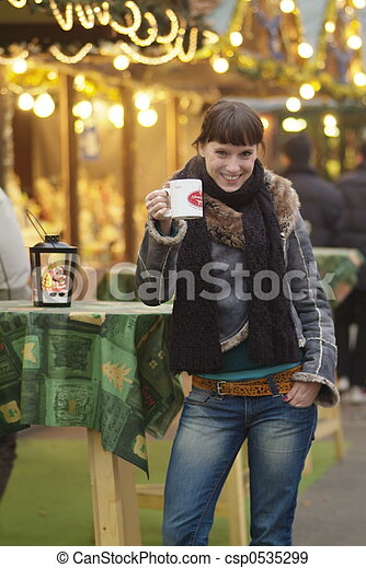 young woman drinks glogg - csp0535299