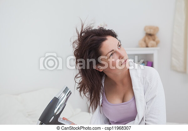 Young woman drying hair - csp11968307