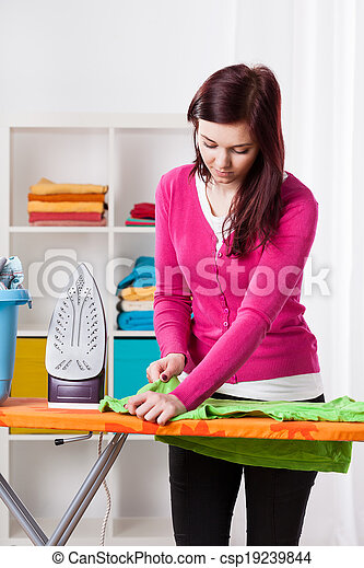 Young woman during ironing - csp19239844