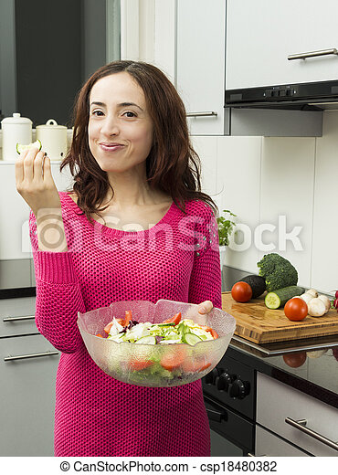 Young woman eating healthy food - csp18480382