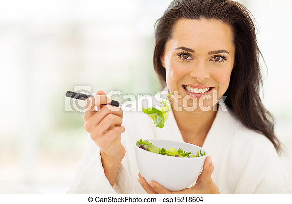 young woman eating healthy food - csp15218604
