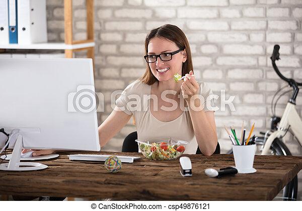 Young Woman Eating Salad - csp49876121
