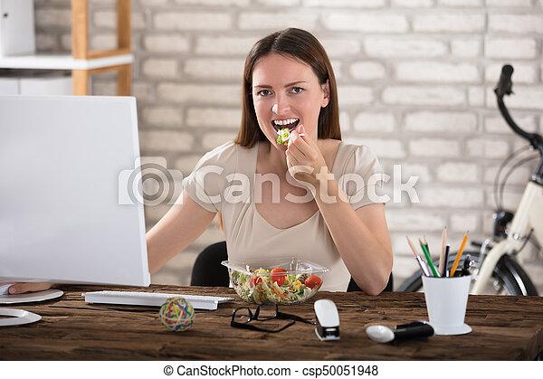 Young Woman Eating Salad - csp50051948