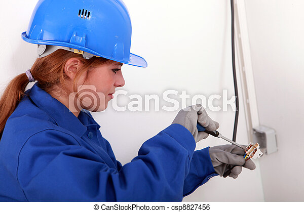 Young woman electrician - csp8827456