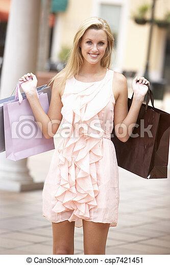 Young Woman Enjoying Shopping Trip - csp7421451