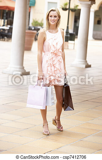 Young Woman Enjoying Shopping Trip - csp7412706