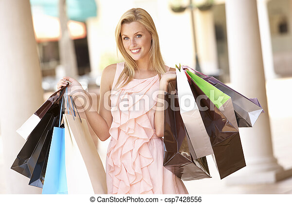 Young Woman Enjoying Shopping Trip - csp7428556