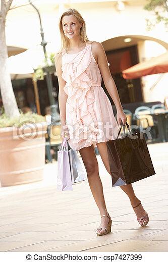 Young Woman Enjoying Shopping Trip - csp7427399