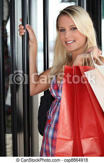 Young woman entering in a store - csp8864918