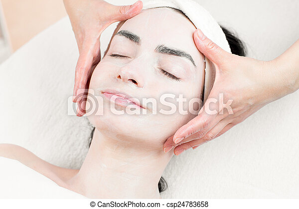 Young woman facial massage in beauty parlour - csp24783658