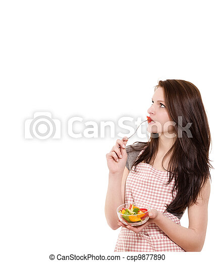 young woman from side eating salad looking up on white background - csp9877890