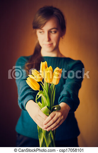 Young woman girl holding flowers - csp17058101