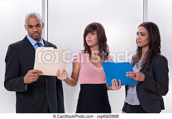 Young woman giving tasks to her colleagues - csp6920888