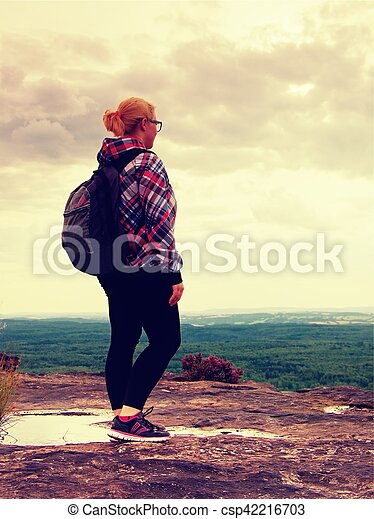 Young Woman hiker takes a rest on peak of the Mountain - csp42216703