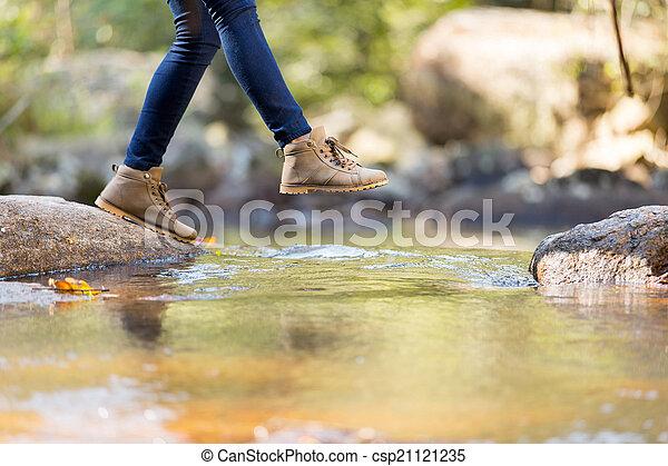 young woman hiking in mountain - csp21121235