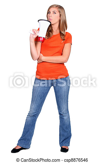 Young woman holding a bullhorn standing in front of white background - csp8876546