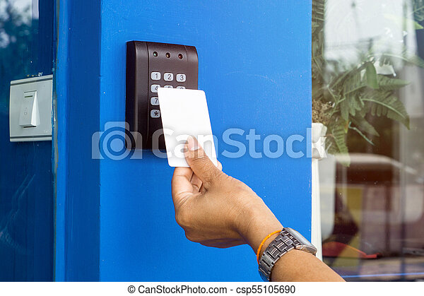 Young Woman Holding A Key Card To Lock And Unlock Door.   Csp55105690