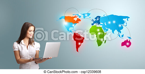 Young woman holding a laptop and presenting colorful world map - csp12339608