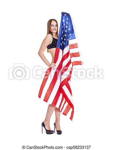 Young woman holding a large American flag - csp58233137