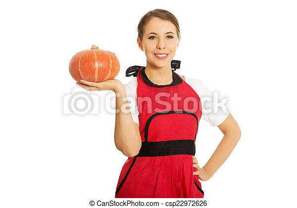 Young woman holding a pumpkin - csp22972626