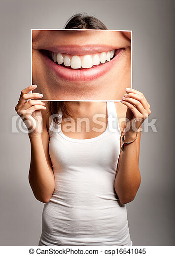 young woman holding a smile - csp16541045