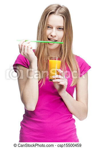 young woman holding glass of orange juice - csp15500459