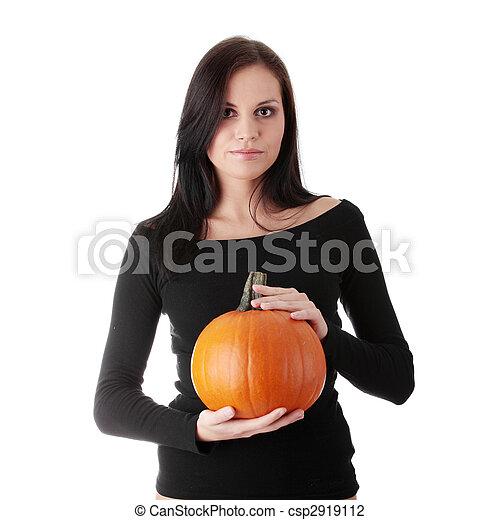 Young woman holding orange pumpkin - csp2919112
