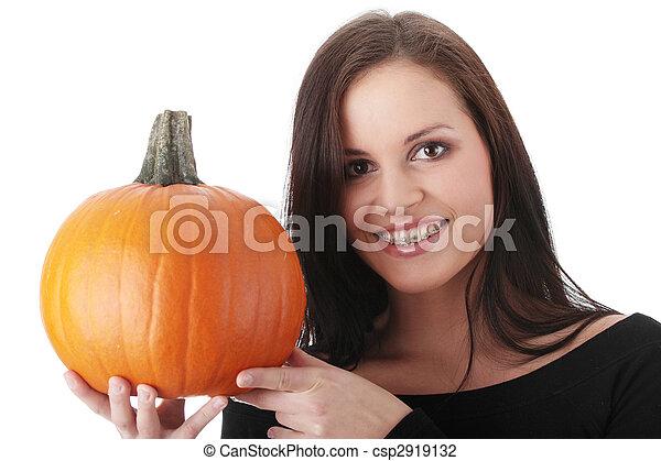 Young woman holding orange pumpkin - csp2919132