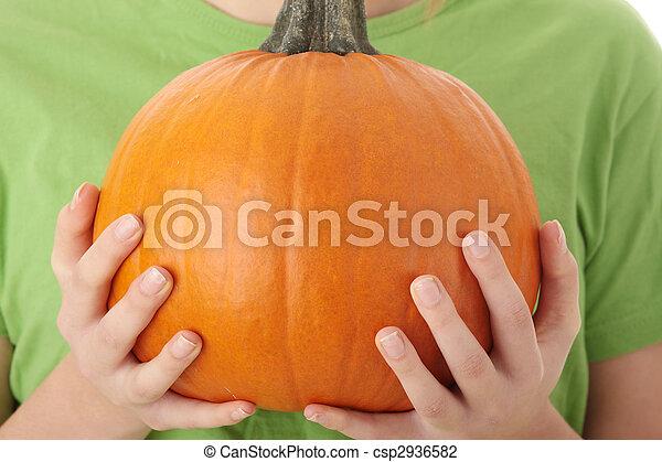 Young woman holding orange pumpkin - csp2936582