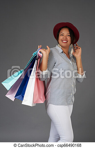 Young woman holding shopping bags - csp66490168