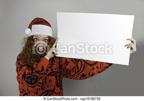 c24f54df2d2e5 Young woman holding sign. Pretty young woman wearing santa hat and ...