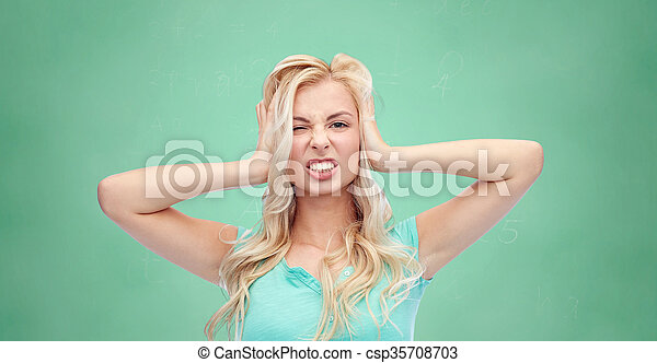 young woman holding to her head and screaming - csp35708703