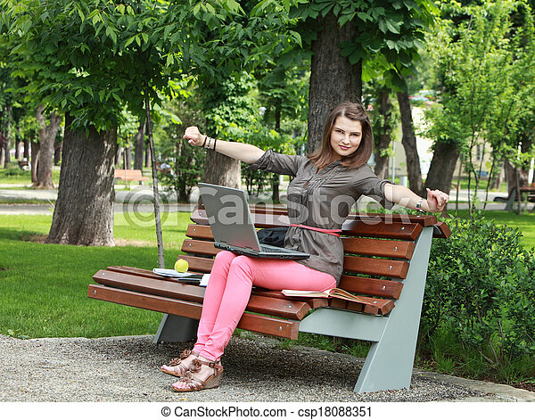 Young Woman in a Park - csp18088351
