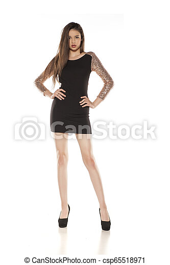 Young woman in a tight black dress - csp65518971