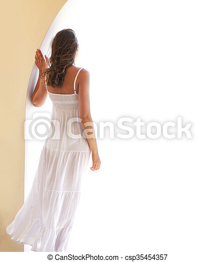 Young woman in a wite dress chilling - csp35454357