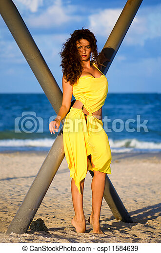 Young woman in a yellow dress - csp11584639