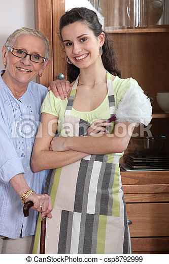 Young woman in an apron with an elderly lady - csp8792999
