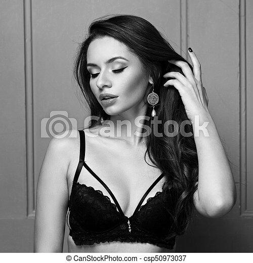 274066f88e2 Young woman in black strappy bra. Portrait of seductive young woman ...