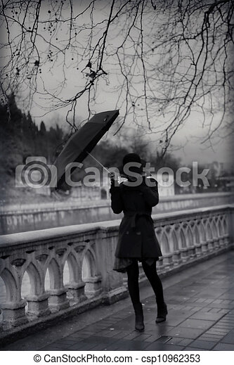 Young woman in coat with umbrella - csp10962353