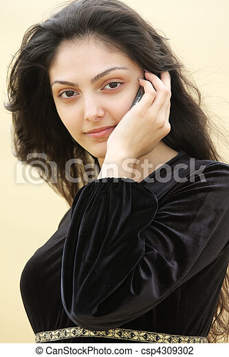 Young woman in desert calling by cellphone closeup - csp4309302