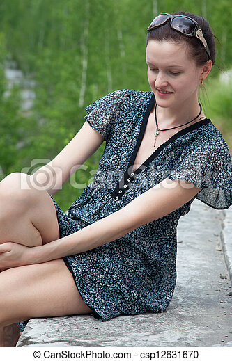 Young woman in dress sitting - csp12631670