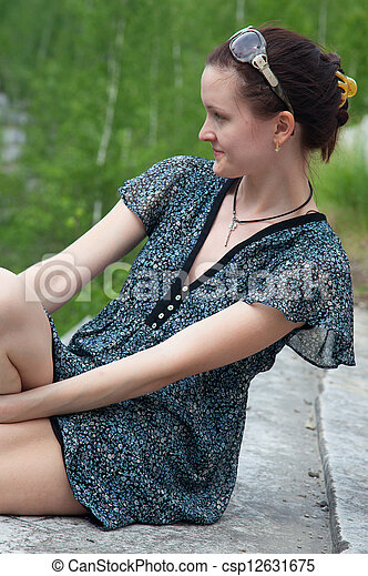 Young woman in dress sitting - csp12631675