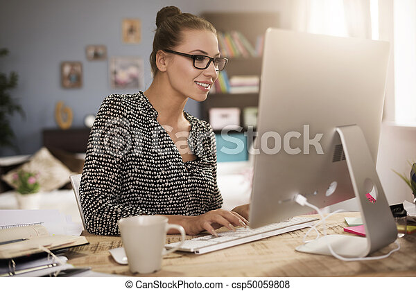 Young woman in front of her computer - csp50059808